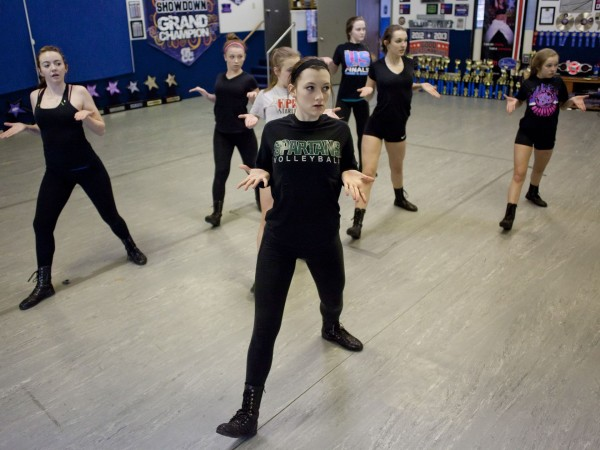 Senior Starlites' Adrienne Slossar, 15, front, practices her hip-hop dance routine with her team Wednesday at the Huron Physical Arts Center in downtown Port Huron. The Starlites will be traveling to Orlando, Fla., on April 24 to compete in the Dance Worlds competition. (Photo: JEFFREY M. SMITH/TIMES HERALD)